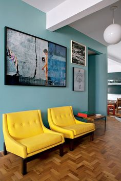 Mint colored living room with yellow details